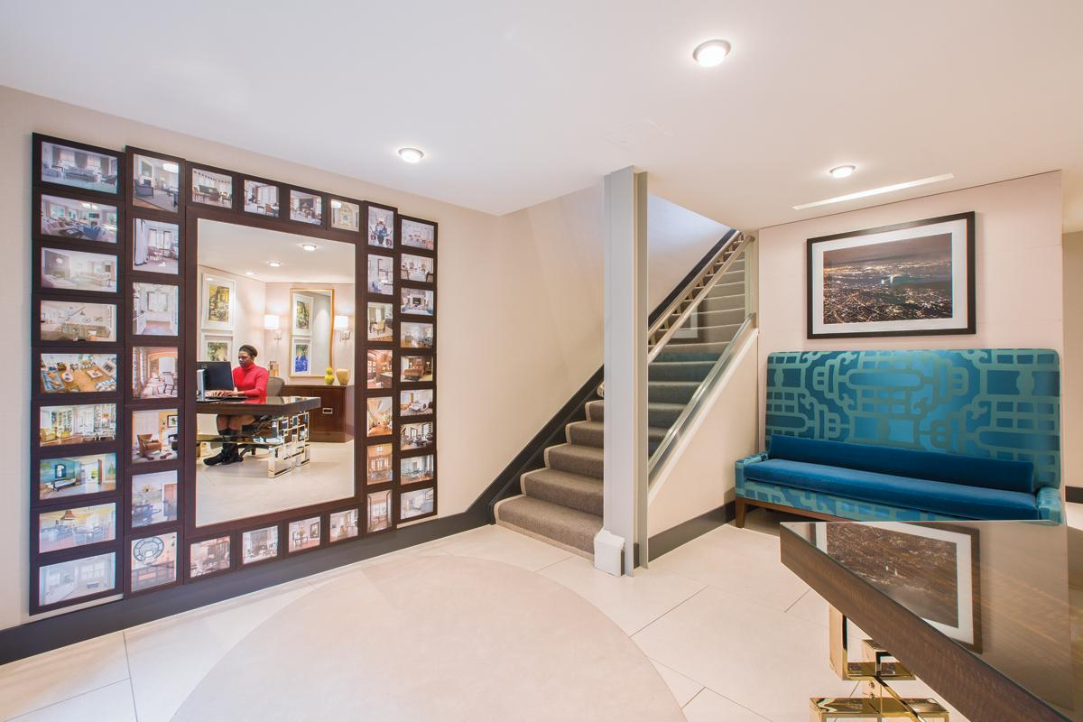 The reception area features a mirror framed by photographs of Sroka's projects.
