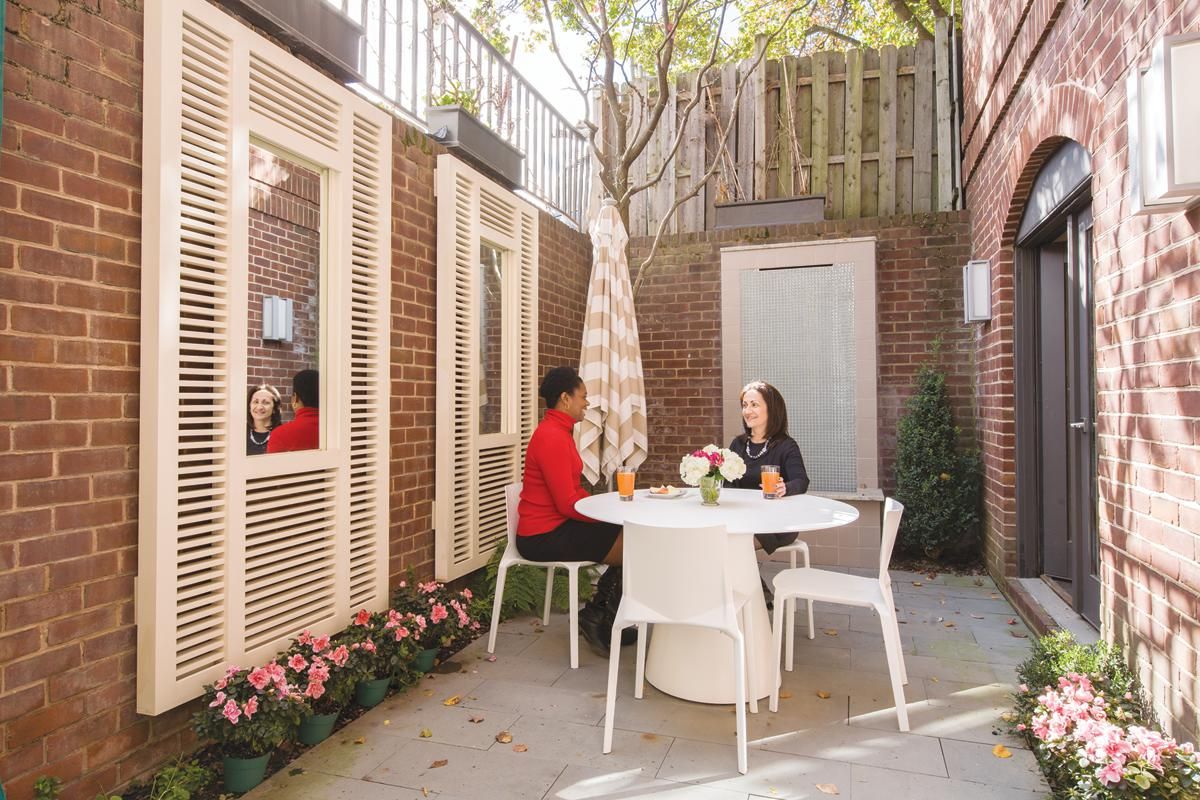 A small, brick-walled courtyard makes a welcome spot for a break.